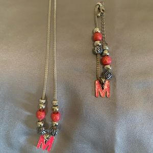 "An ""M"" Necklace and bracelet set from Justice"